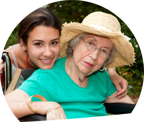 elder on a wheelchair with caregiver